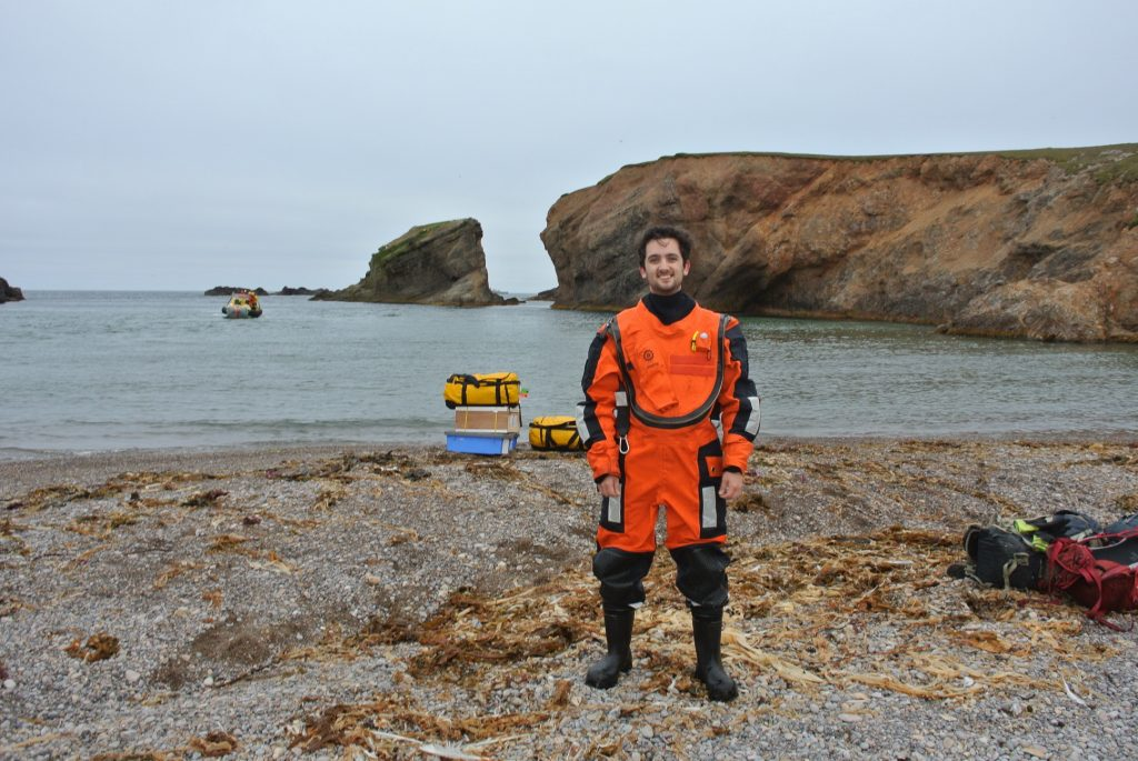 Sean on the beach in a dry suit