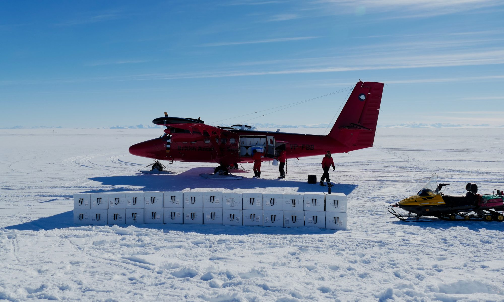 Photo of people loading up a Twin Otter aircraft with ice core boxes