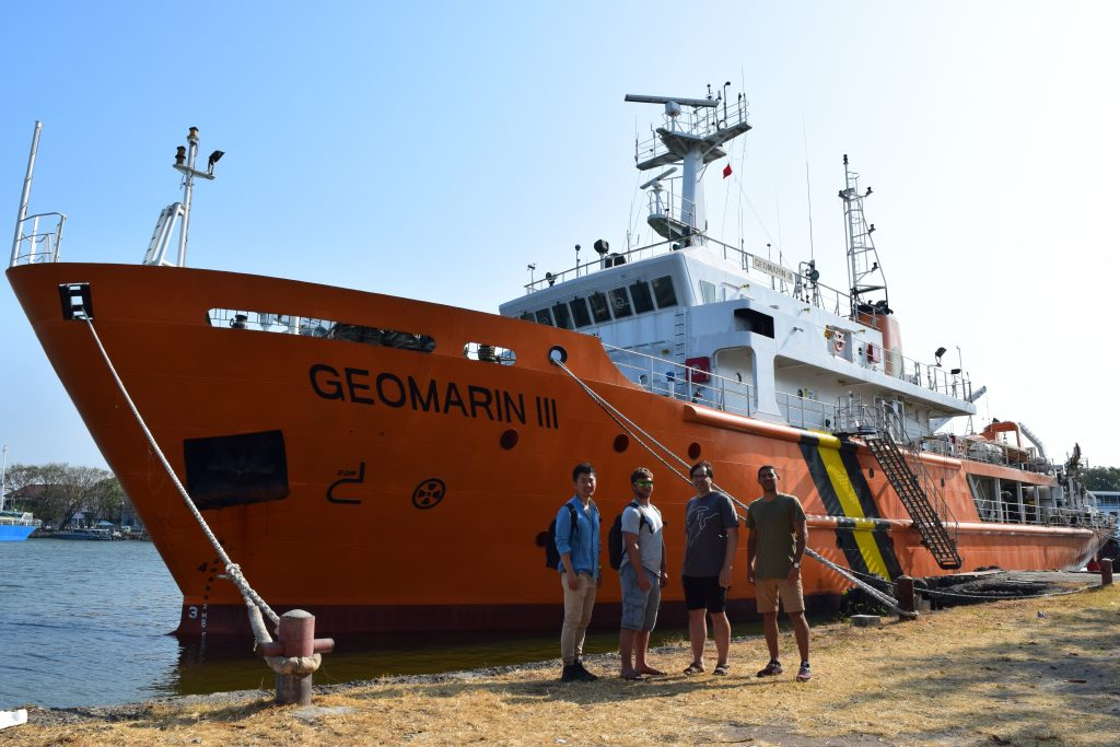 Cambridge scientists stood in front of the research vessel, 'Geomarin III', that took them on their ocean bottom seismometer deployment.