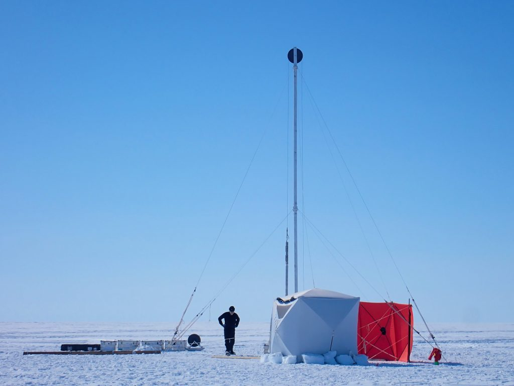 A photo of the Sherman Island drill site set-up, with mast, anchors, and shelters all in place.